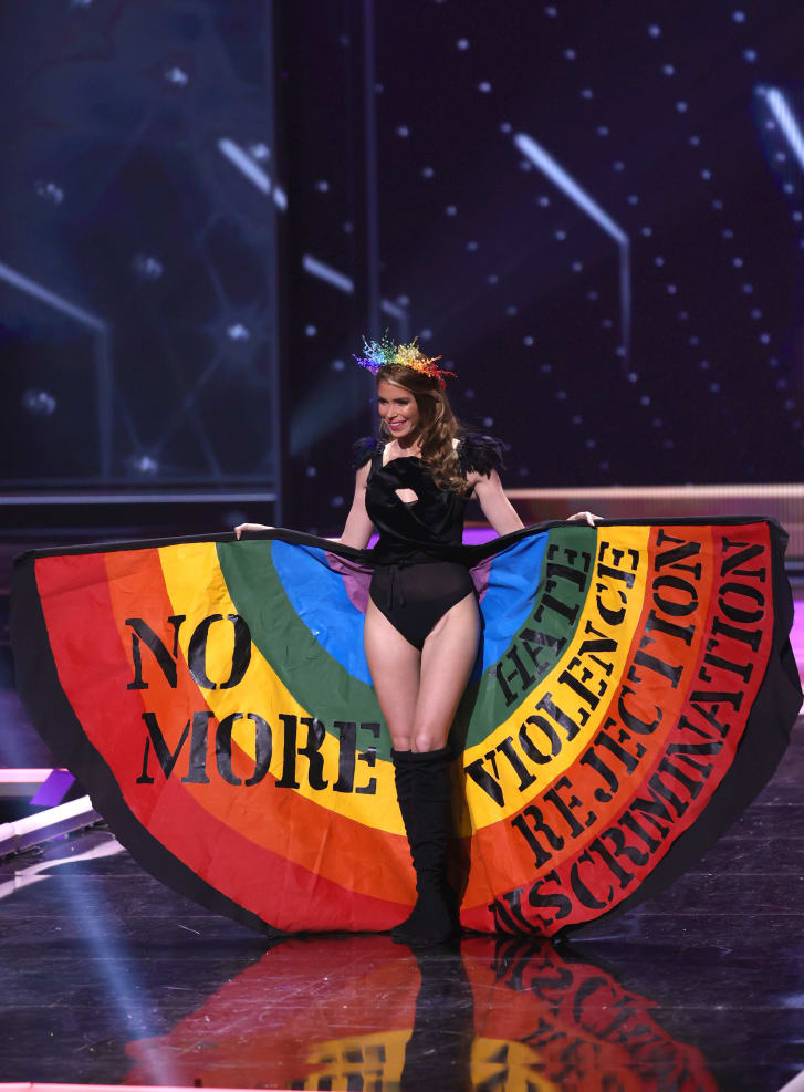 Miss Universe Uruguay Lola de los Santos holds up her rainbow skirt in support of the LGBTQ+ community at Miss Universe 2021. Credit: Rodrigo Varela/Getty Images